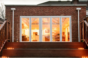 Orangery with bi-folding doors by Anglian Home Improvements myglazing ggf