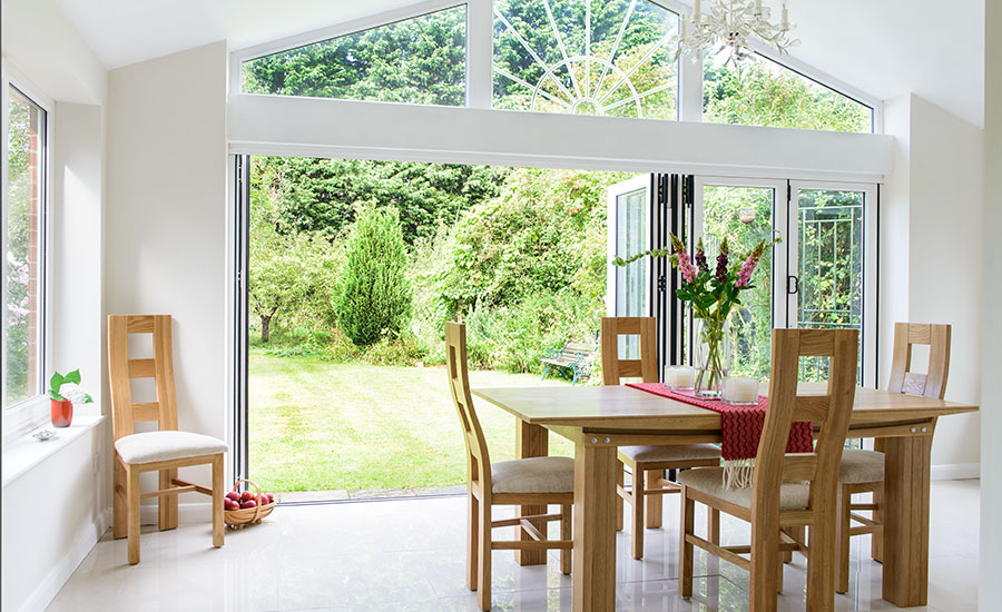 White PVCu Extension With Gable End And Bi Folding Doors By Anglian