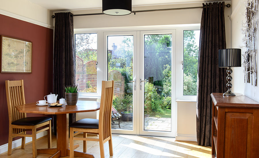 Dining Room Featuring White French Doors By Anglian Home Improvements
