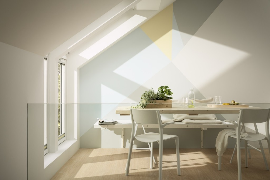 Sun shining through Velux roof windows onto table and chairs