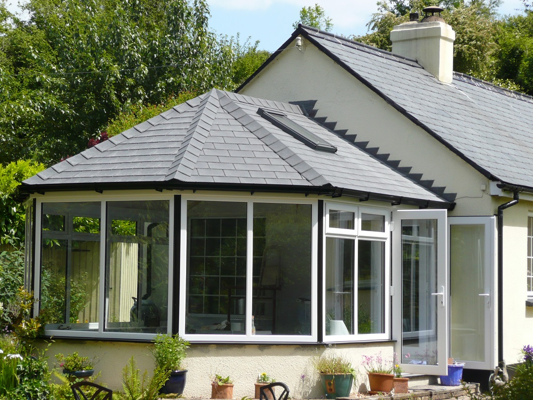 Conservatory with tiled roof on end of gabled house