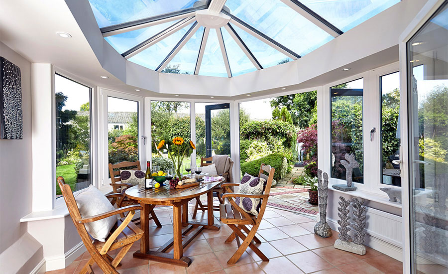 interior of conservatory with dining table and chairs