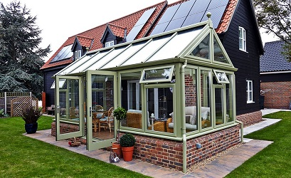 Edwardian gable conservatory with green framework by Anglian Home Improvements