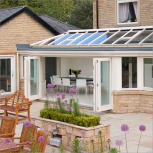 house with conservatory and open bifold doors