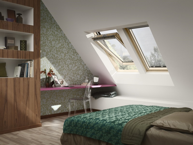bedroom with bed, desk and roof windows