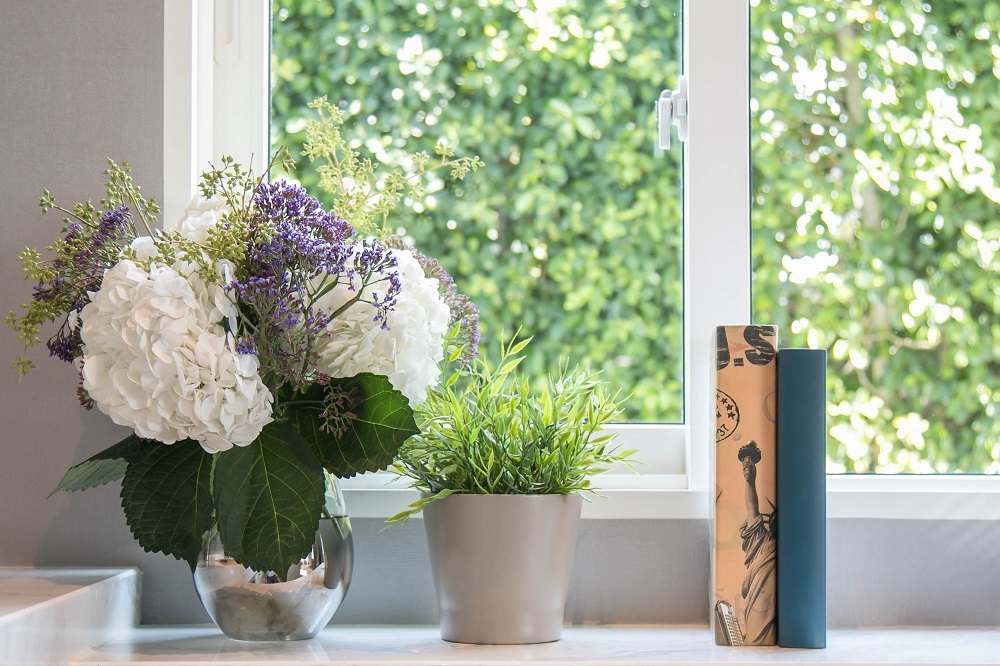 windowsill with flowers and books